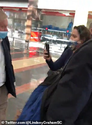 When the woman pictured told Graham she is from Seattle he said: 'Seattle's a good example of how things are getting out of control,' citing civil unrest and protests in the city