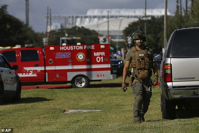 The officers were shot before a SWAT team was dispatched to the scene