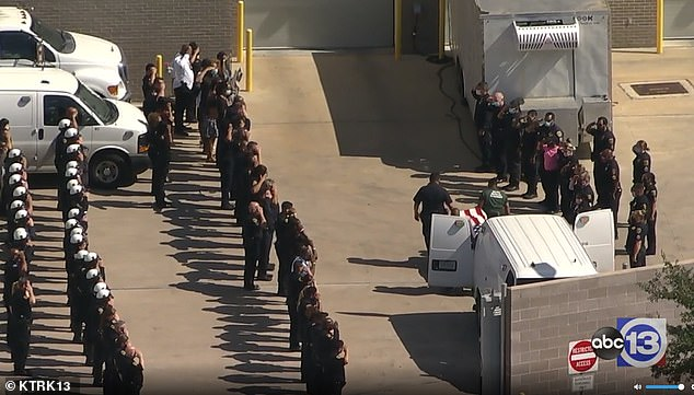 After the press conference, Houston officers escorted Preston's body to the medical examiner's office where they saluted the fallen officer
