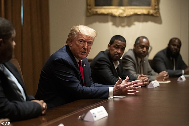 Whitlock claimedTrump's 'masculinity' and his disdain for political correctness were 'things that a lot of black men can relate to'. The President is pictured during a roundtable discussion with African-American supporters back in June