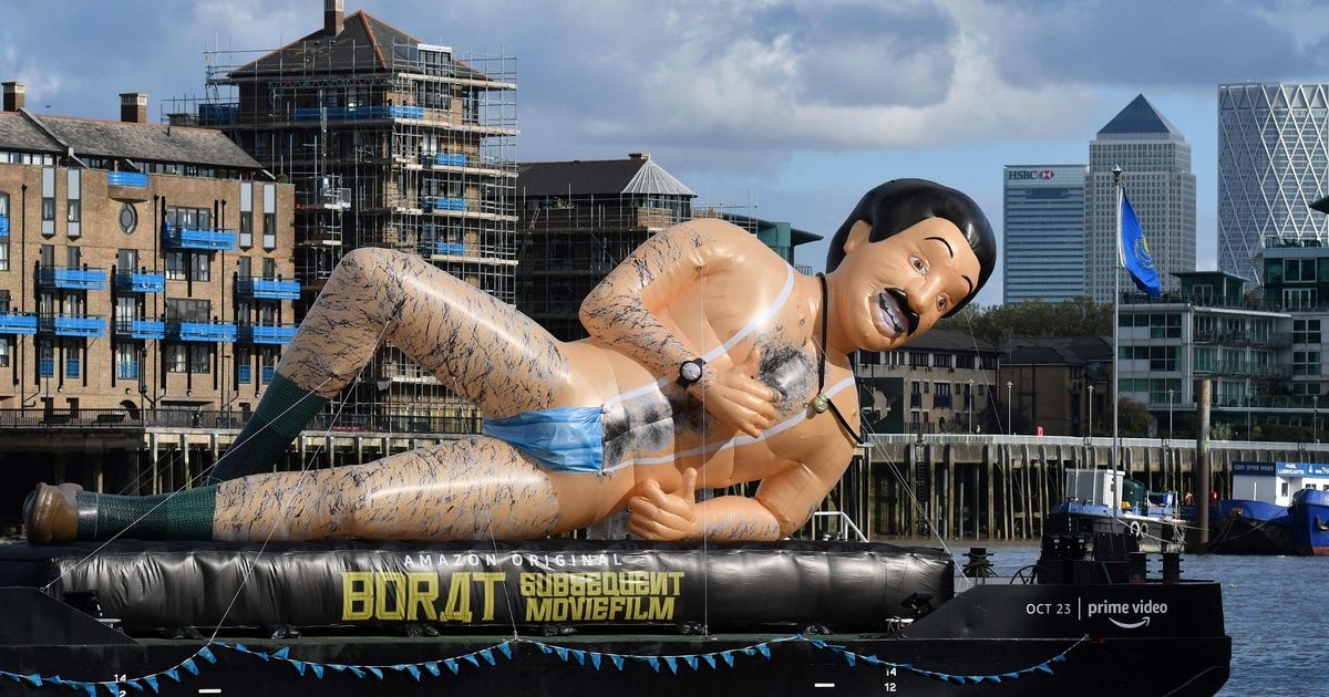 Giant Borat inflatable clad in trademark mankini spotted floating down Thames