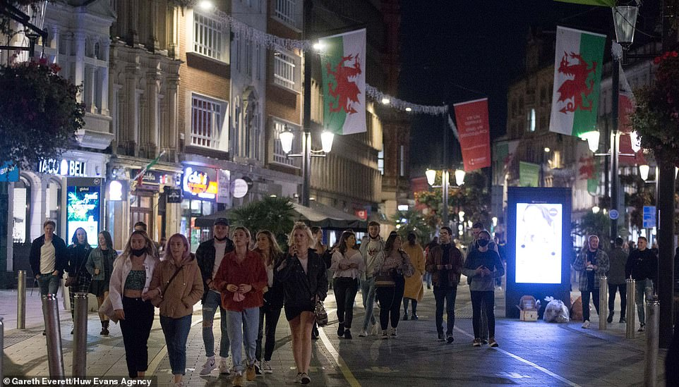 Revellers took to the streets of Cardiff last night to enjoy one more night on the town before the new lockdown comes in today
