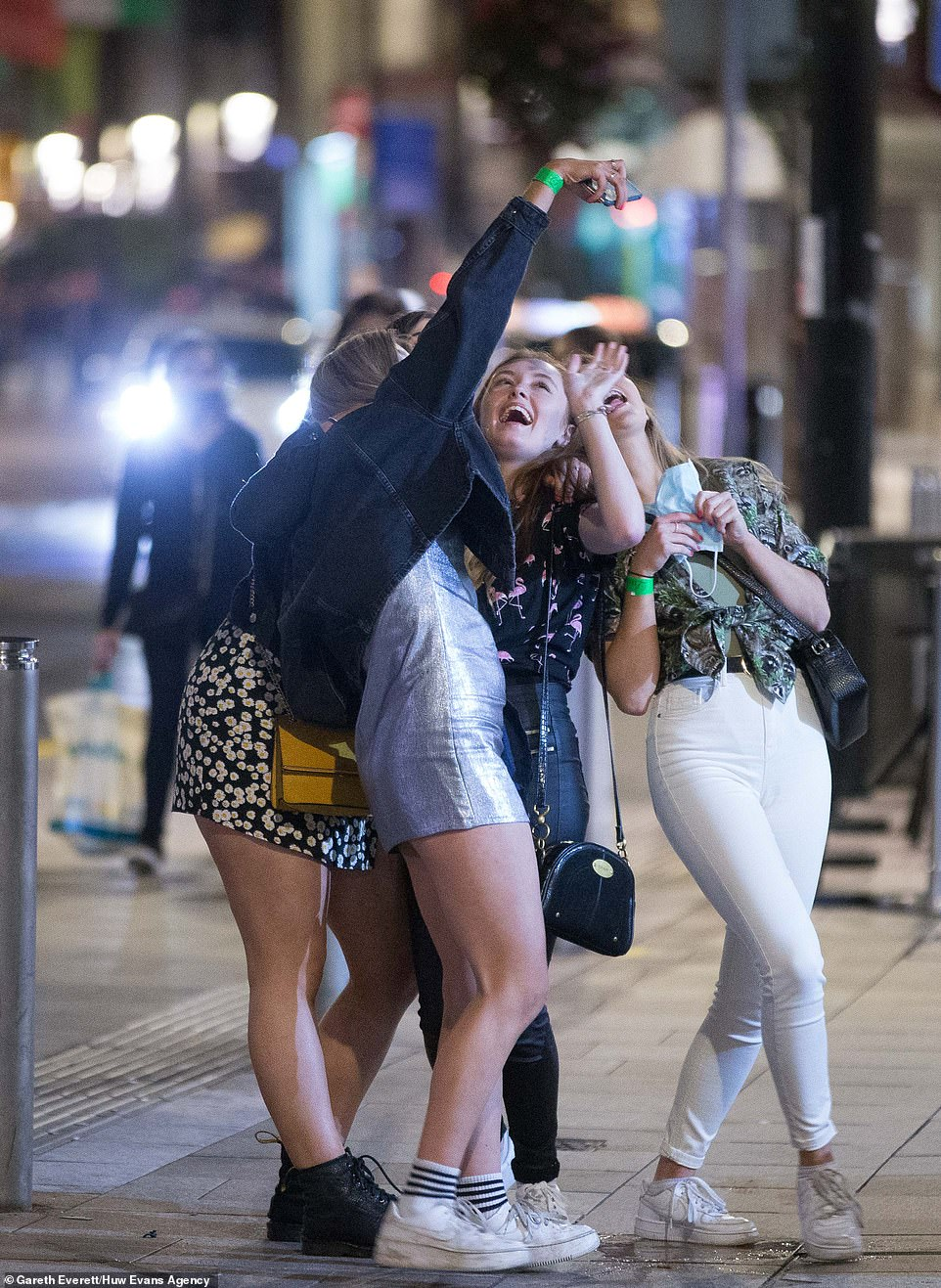 A group of girls pose for a selfie on a night out in Cardiff before Wales goes into a 17-day lockdown from 6pm on Friday