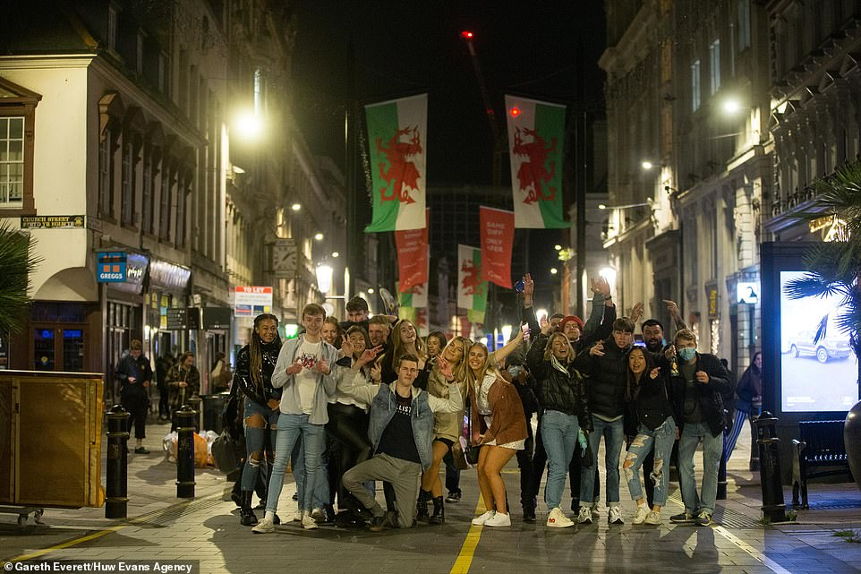 A group of young people pose in Cardiff last night as they make the most of a night out before the Welsh lockdown