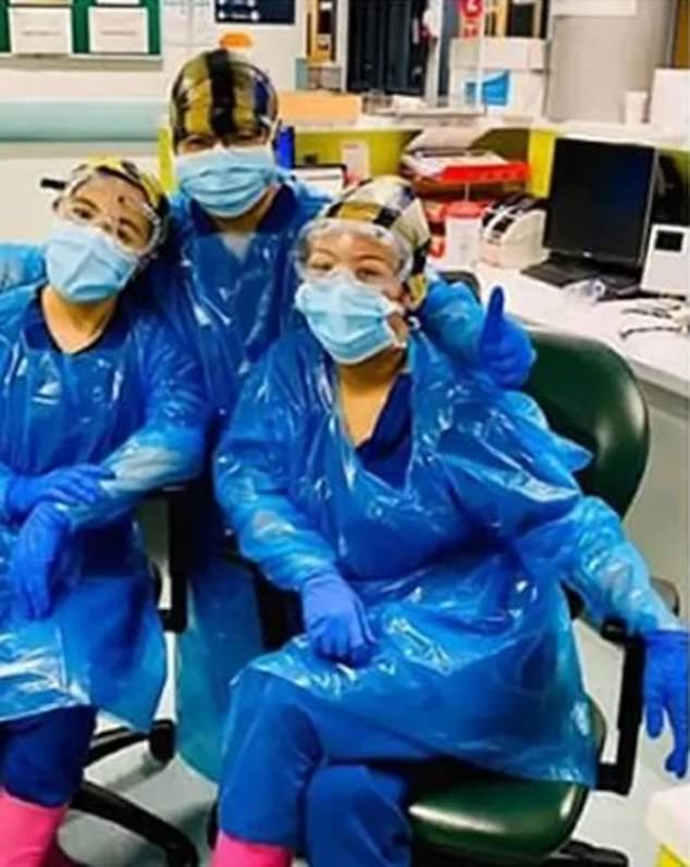 Nurses pictured wearing clinical waste bags on their heads at Northwick Park hospital in March