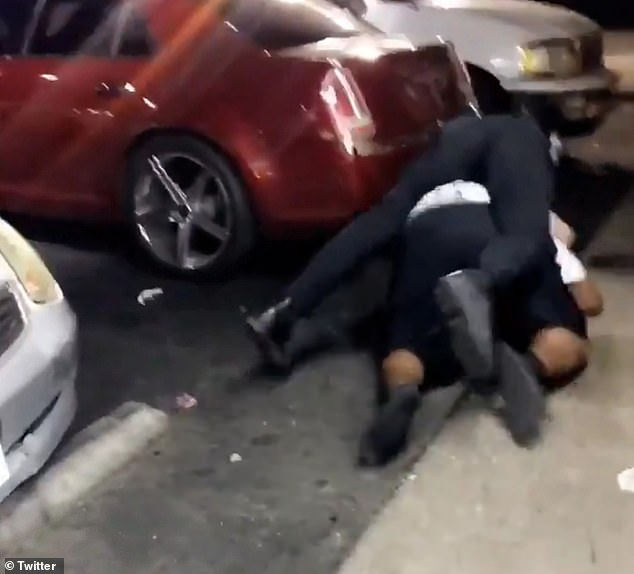 The footage shows the cop wrestling Bender to the ground and on top of the black man as he struggles