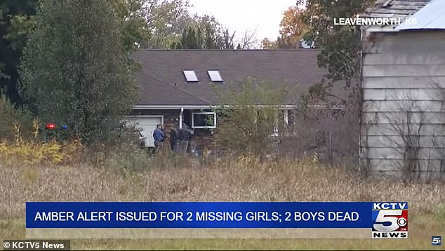 Police are pictured on Saturday near the Jackson family home in Leavenworth, Kansas