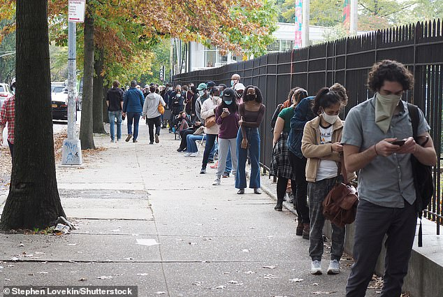 People stand in line for early voting at The Brooklyn Museum in Brooklyn, New York