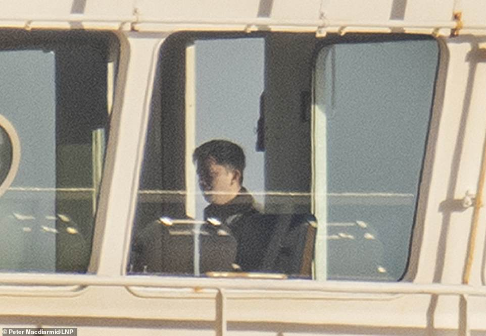 The Special Boat Service (SBS) raided the tanker yesterday evening off the Isle of Wight after stowaways were found on board who threatened the crew. Pictured is an official on the boat today