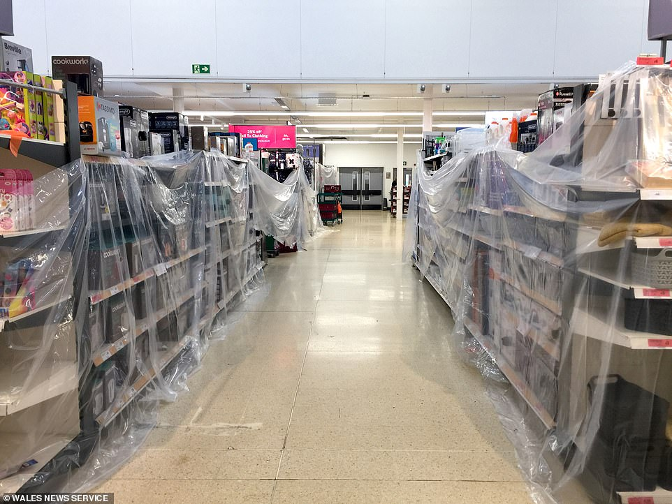 Sainsbury's in Cardiff had put up plastic sheeting to prevent shoppers from buying items that were judge non-essential
