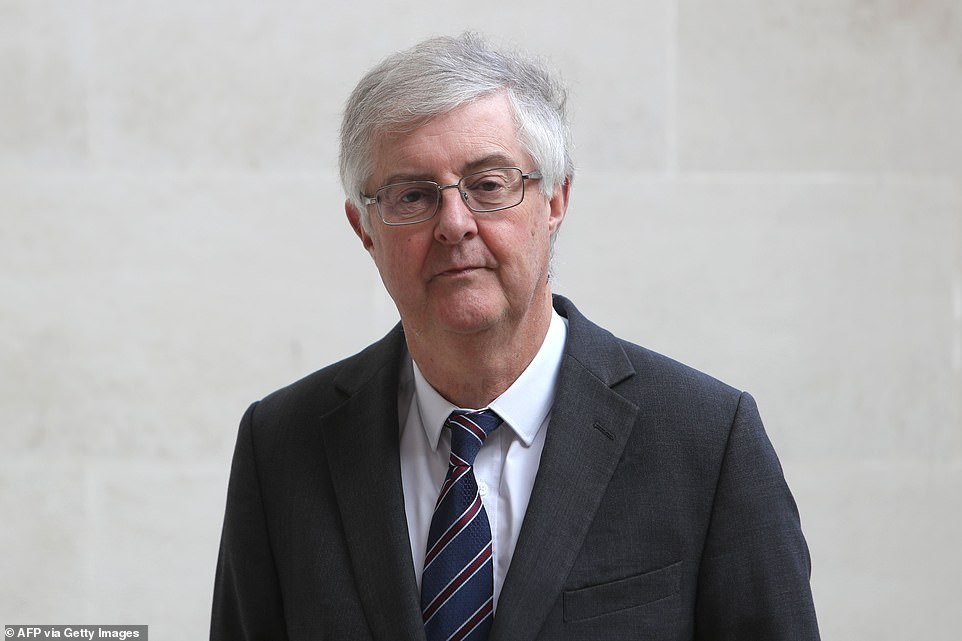 Welsh First Minister Mark Drakeford said supermarkets can use 'discretion' when deciding what items are non-essential after overzealous Tesco 'trolley police' told women they couldn't buy sanitary towels