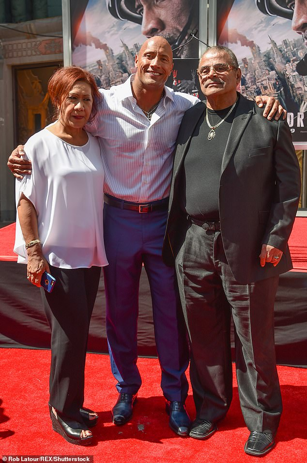'Go rest high': The daughter of wrestling legend 'High Chief' Peter Maivia divorced Johnson's father Rocky (R) in 2003 after 25 years of marriage - and he died, age 75, from a pulmonary embolism on January 15 (pictured in 2015)