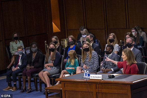 Judge Amy Coney Barrett introduced her family at her confirmation hearing including her children(from left, first row) Liam, Vivian, Tess, Juliet, Emma, J.P. and husband Jesse and then siblings (from left, second row)Vivian, Eileen, Michael, Megan and Amanda. Sister Carrie was seated across the aisle