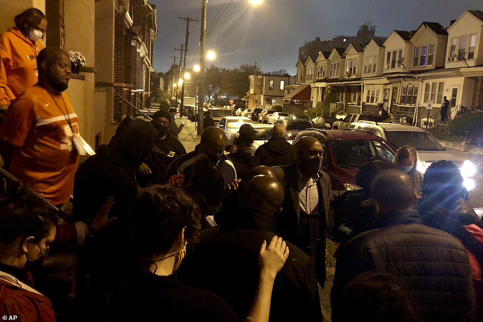 By Monday night, a group of residents took to the streets protesting Wallace's death close to where he was shot, yelling a police and questioning the officers' use of lethal force