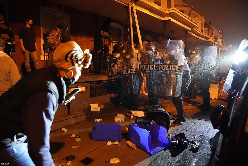 Late into the night, growing anger soon turned into a violent standoff outside the Philadelphia Police 18th District headquarters in the western part of the city as several officers were injured by bricks and other projectiles thrown at them by a crowd of demonstrators