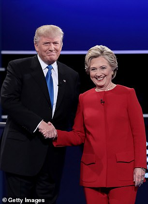 Democratic presidential nominee Hillary Clinton takes the stage with Republican presidential nominee Donald Trump during the Presidential Debate at Hofstra University on September 26, 2016