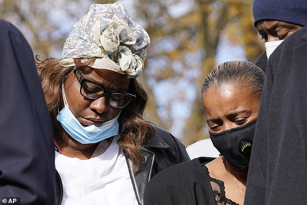 Marcellis Stinnette's mother Zharvellis Holmes, left, and Marcellis's grandmother Sherrellis Stinnette attend a press conference, Wednesday, Oct. 28, 2020.The couple's families and lawyers had hoped that bodycam footage would establish the truth behind the shooting