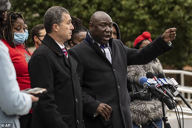 Family and supporters of Tafara Williams listens as attorney Ben Crump speaks Tuesday.Benjamin Crump, a civil rights attorney who is representing Williams, said the video clips were evidence of 'police creating a false narrative'