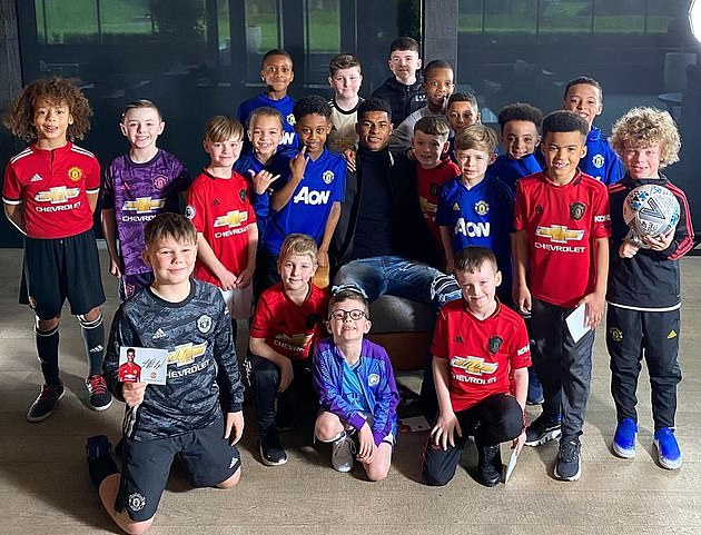 Marcus Rashford (middle) was recently awarded an MBE for his work feeding underprivileged children
