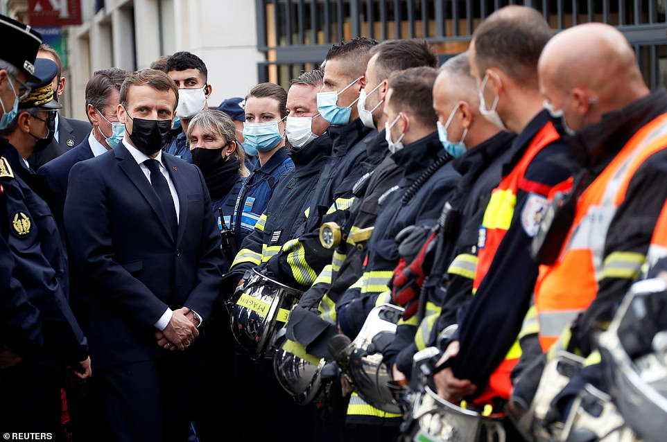 President Emmanuel Macron visits the scene of a reported knife attack at Notre Dame church in Nice