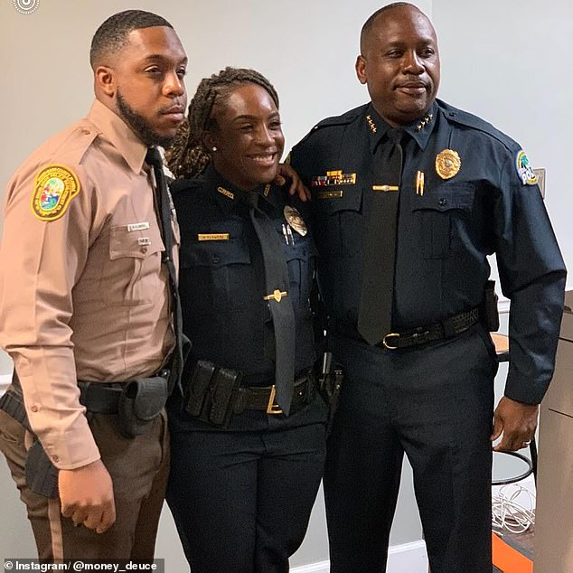 Flowers with his father and sister who are both cops. Flowers was arrested this week after the DEA source set up international money-laundering deals with a suspected money launderer who then got the two cops involved, boasting Flowers was on his payroll