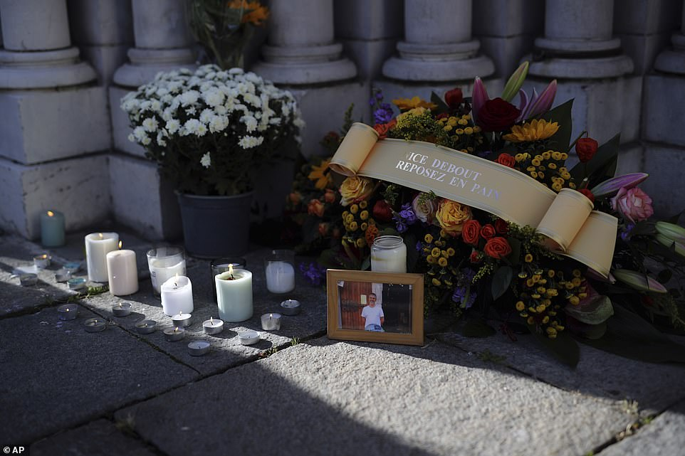 Flowers, messages and candles lie in front of the Notre Dame church, in Nice, France