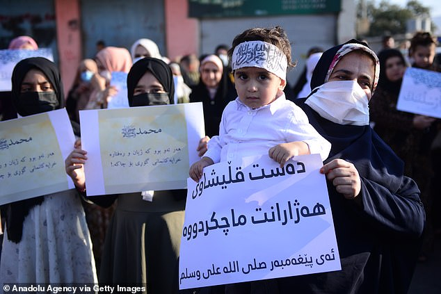 Iraqis protest against comments by French President Emmanuel Macron defending cartoons of the Prophet Mohammed in Halabja, Iraq today