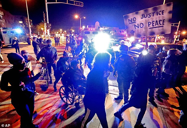 BLM rioters smash the windows of HOMES in Milwaukee suburb