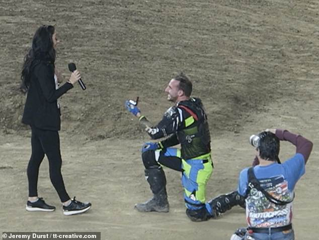 Biker fakes crash to propose to his shocked girlfriend in front of crowds at motocross event