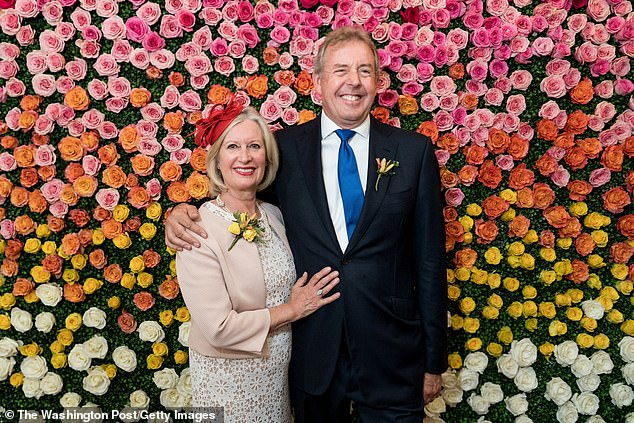 Former British Ambassador Kim Darroch and his wife Vanessa post together in 2018. Darrock was investigated over an alleged affair with a CNN journalist - Michelle Kosinski. He was later cleared of wrongdoing following a probe by the Department of Justice