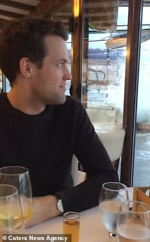Couple's romantic dinner is ruined when waves crash into lakeside restaurant and flood it