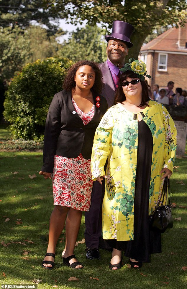 Dawn French, pictured in 2005 with former husband Lenny Henry and their adopted daughter Billie, said that after living in a 'multicultural family', for her 'the norm is to write any colour she likes'