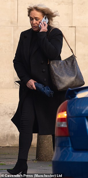 Deputy headmaster's estranged wife, 60, dug her nails into his arm during doorstep confrontation
