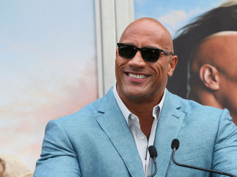 """Dwayne """"The Rock"""" Johnson presents bottles of tequila to a fan on his 101st birthday 
