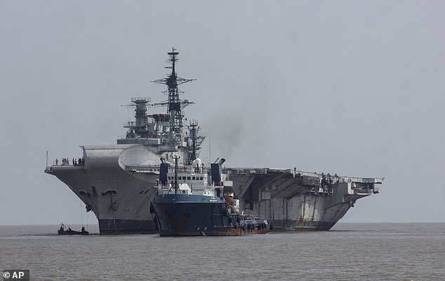 Farewell: Veteran aircraft carrier HMS Hermes heading to the breakers' yard in Alang, Gujarat, to be broken up for scrap