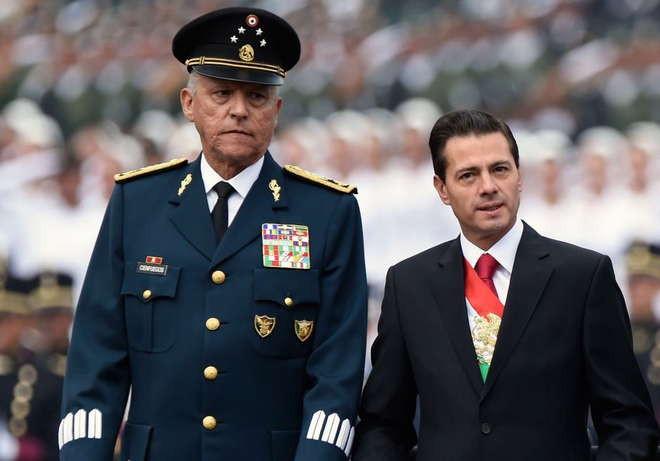 """Former Mexican Defense Secretary faces 4 drug trafficking charges in court where """"El Chapo"""" was tried 