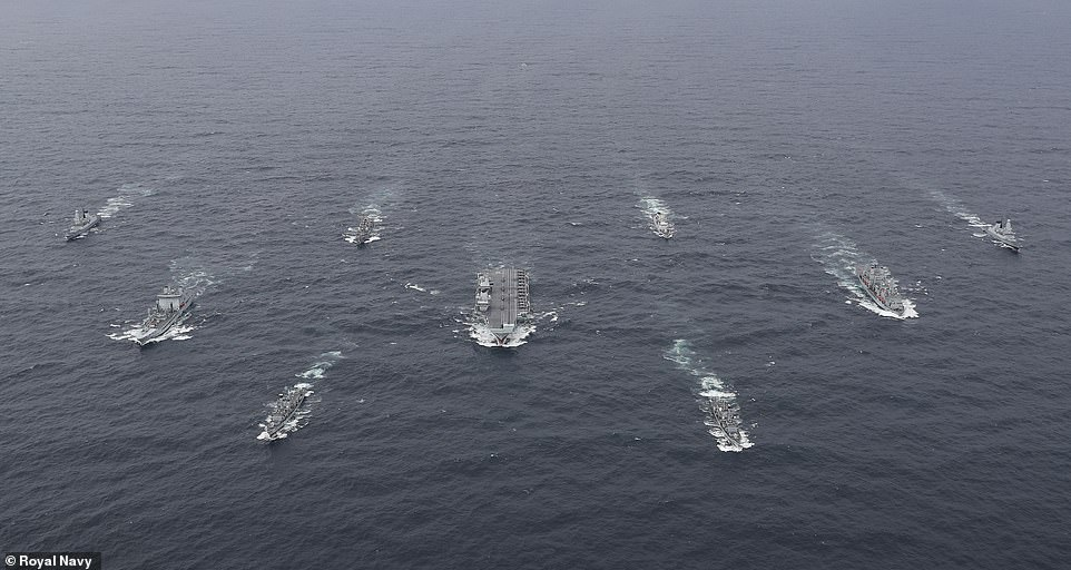 HMS Queen Elizabeth leads flotilla of ships as new carrier strike group assembles for first time