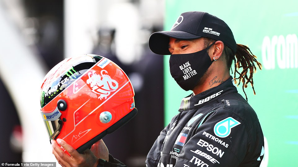 Hamilton is left stunned as Schumacher's son presents him with one of his father's crash helmets