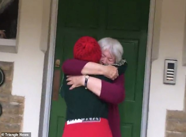 Heartwarming moment boy, 11, finally gives his gran a cuddle after walking 1,700 miles