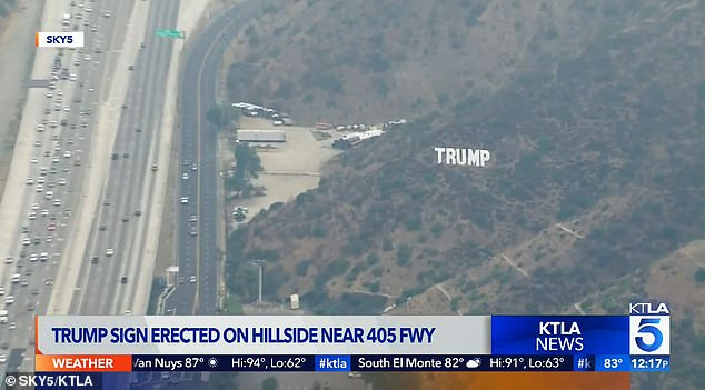 Huge Hollywood-style Trump sign is erected beside LA freeway