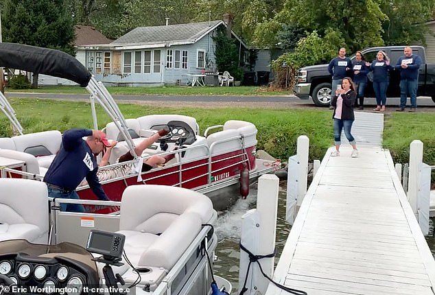 Colton Brownlee, from Lake Geneva, Wisconsin, planned to pop the question to his girlfriend, Julie Palmer, as she docked her boat on Lake Como,Wisconsin - but the picturesque proposal did not go quite to plan