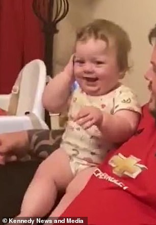 It's for you! Baby's hilarious reaction when the phone she is playing with suddenly rings