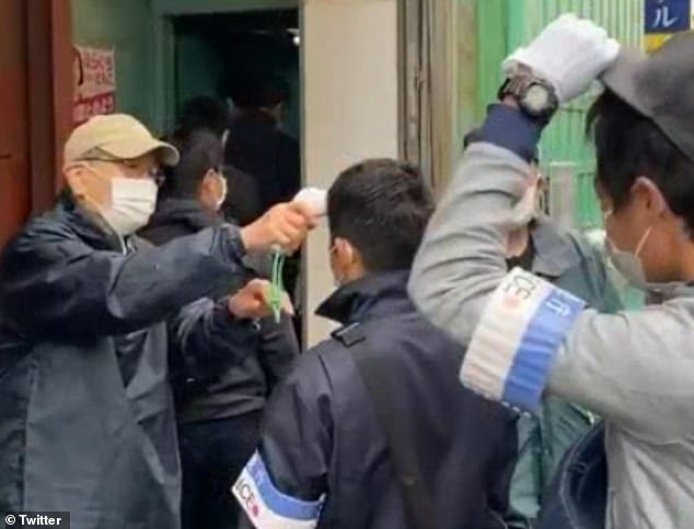 Japanese police pause raid so suspects can come out and check their temperatures for coronavirus