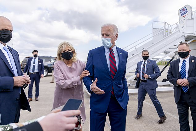 Jill Biden pulls Joe away from reporters when he gets too close as COVID concerns continue