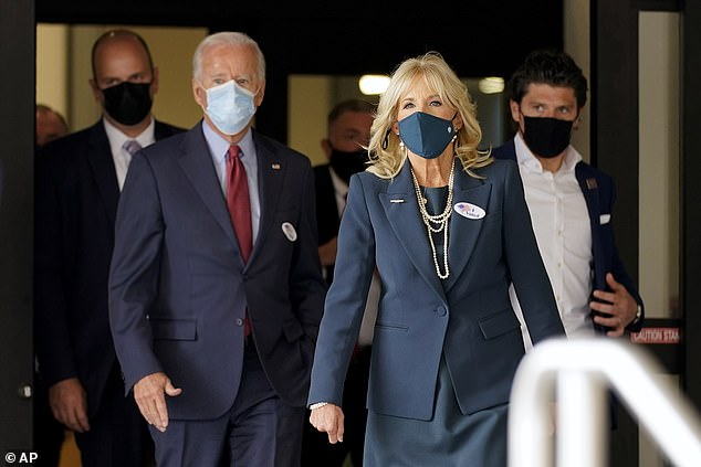 Joe Biden casts his vote early with Jill and will hold Saturday rally with Obama in Michigan