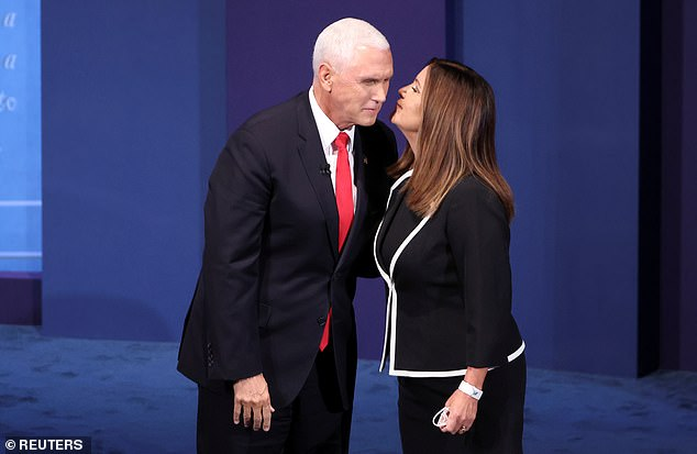 Karen Pence takes off her mask to join her husband Mike at debate