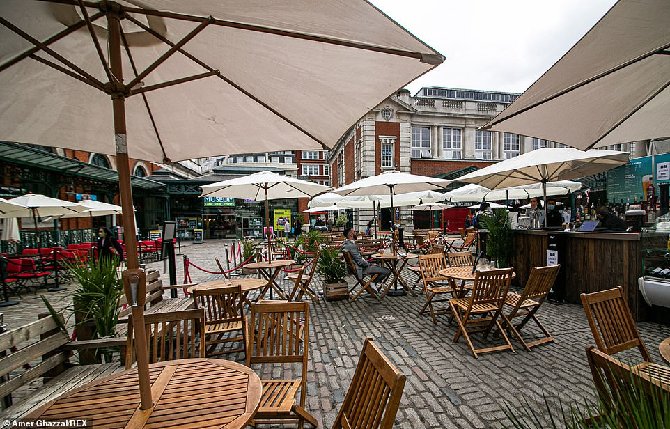 London's normally-bustling streets empty with bars deserted on day one of new Tier 2 lockdown