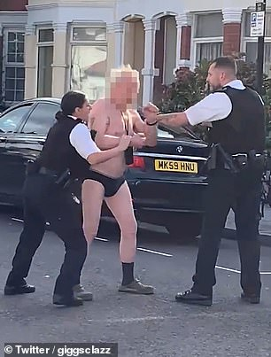 Man in pants confronts police in street with two-foot-long machete