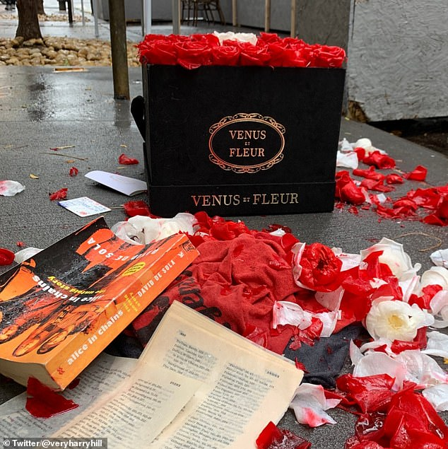 Man shares photos of $399 box of red roses – and an apology – dumped in the rain in New York
