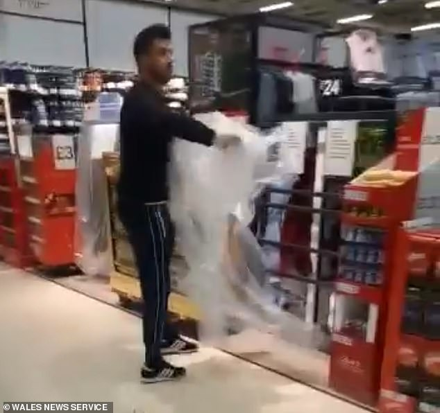 Moment furious Tesco shopper yells 'rip the f***ers off' as he tears plastic from items in Wales